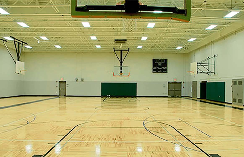 School gym and hall with LED lighting savings on electricity bills